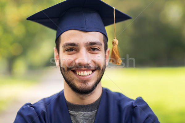 close up of student or bachelor in mortar board Stock photo © dolgachov