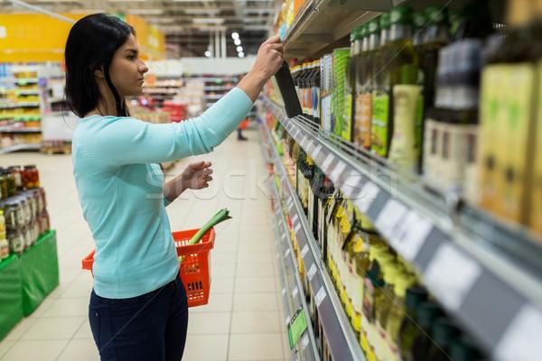女性 オリーブオイル スーパーマーケット 食料品 販売 ストックフォト © dolgachov