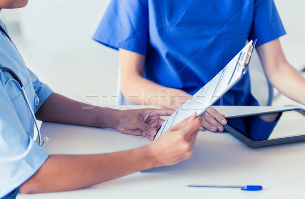 Stock photo: close up of doctor with medical report at hospital