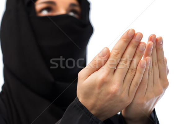 close up of praying muslim woman in hijab  Stock photo © dolgachov