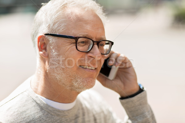 happy senior man calling on smartphone in city Stock photo © dolgachov