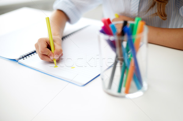 Stock photo: girl drawing with felt-tip pen in notebook