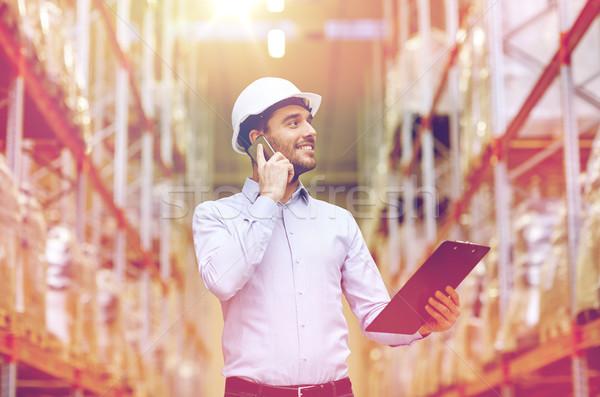 человека буфер обмена смартфон склад оптовая торговля бизнеса Сток-фото © dolgachov