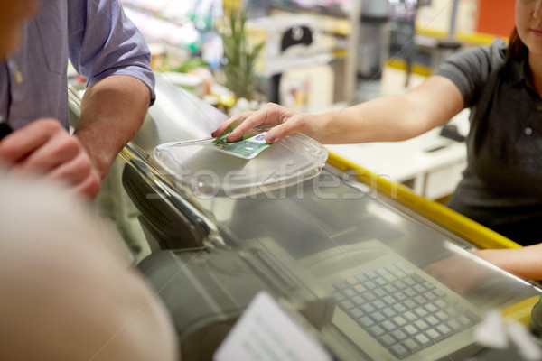 couple paying money at grocery store cash register Stock photo © dolgachov