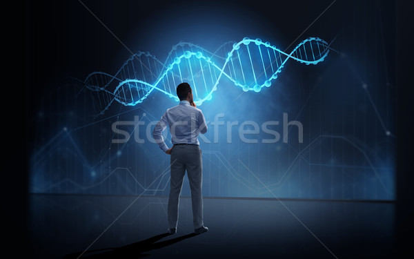 Işadamı bakıyor sanal DNA iş adamları teknoloji Stok fotoğraf © dolgachov