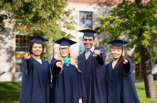Feliz estudiantes solteros senalando dedo educación Foto stock © dolgachov
