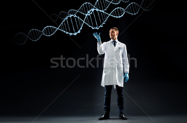 scientist in lab coat and medical gloves with dna Stock photo © dolgachov
