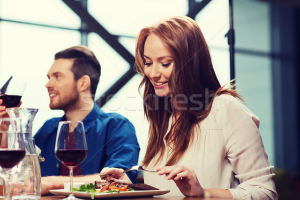 happy couple having dinner at restaurant Stock photo © dolgachov