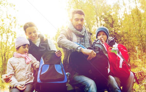 happy family with backpacks at camp Stock photo © dolgachov