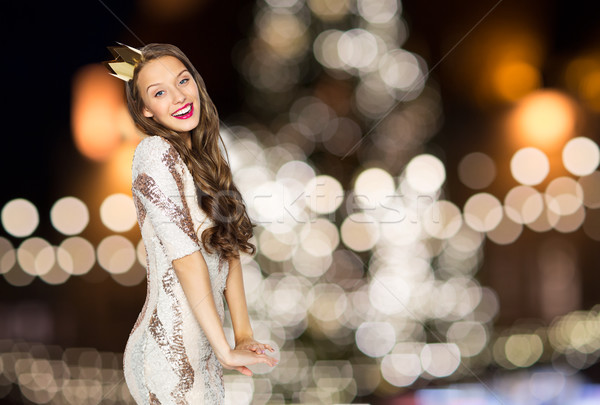 happy woman in crown over christmas tree lights Stock photo © dolgachov