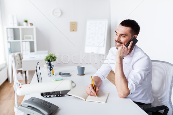 Stock photo: businessman calling on smartphone at office