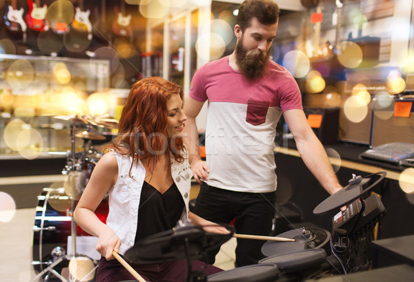 couple of musicians with drum kit at music store Stock photo © dolgachov