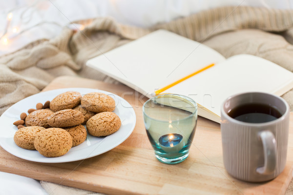 cookies, tea and candle in holder at home Stock photo © dolgachov