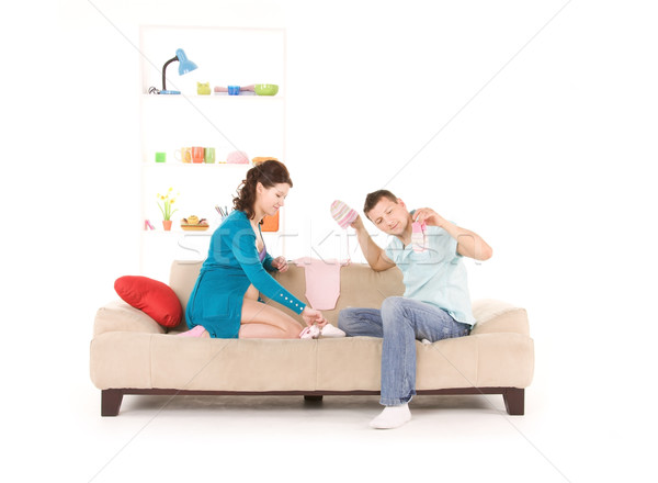 happy couple with childrens clothing Stock photo © dolgachov