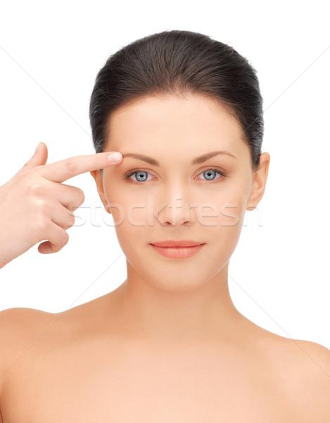 красивая женщина указывая лоб фотография женщину рук Сток-фото © dolgachov