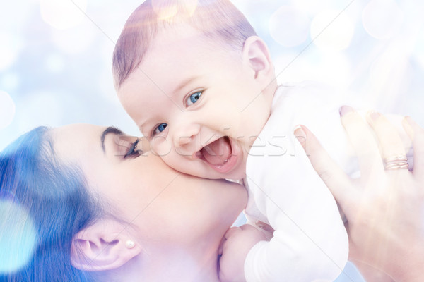 happy mother with baby in hands Stock photo © dolgachov
