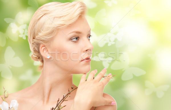 красивая женщина цветы веточка фотография женщину кожи Сток-фото © dolgachov
