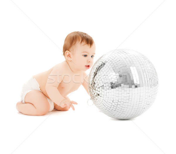 child playing with disco ball Stock photo © dolgachov