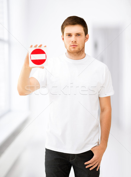 young man showing no entry sign Stock photo © dolgachov