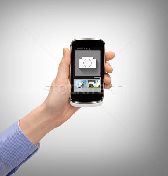 hand with smartphone showing application Stock photo © dolgachov