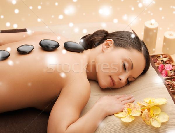 Belle femme chaud pierres santé beauté femme Photo stock © dolgachov