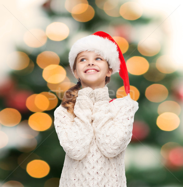 dreaming girl in santa helper hat Stock photo © dolgachov