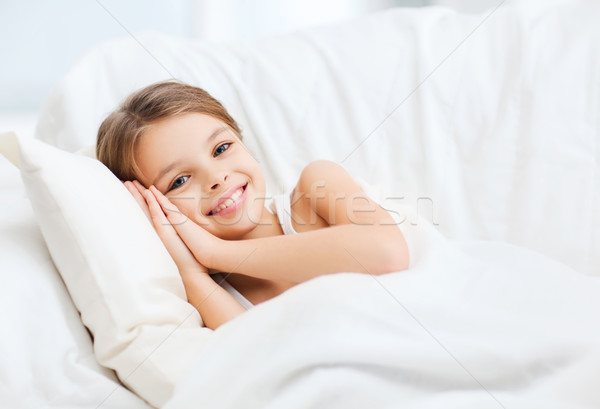 little girl sleeping at home Stock photo © dolgachov