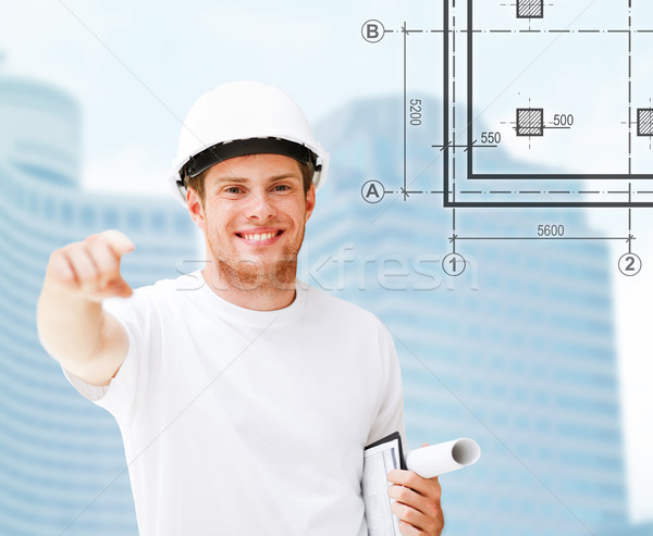 male architect in white helmet pointing at you Stock photo © dolgachov