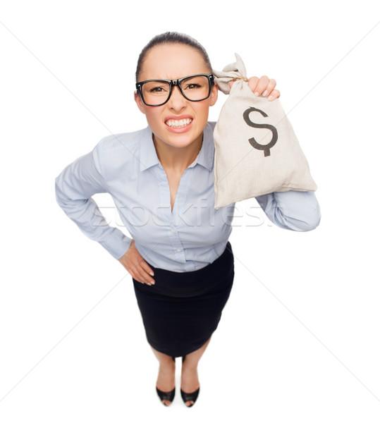 Mérges üzletasszony tart pénz táska dollár Stock fotó © dolgachov