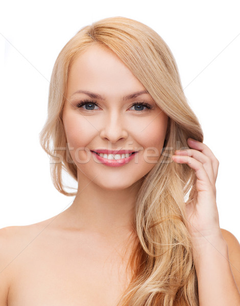 beautiful woman playing with long hair Stock photo © dolgachov