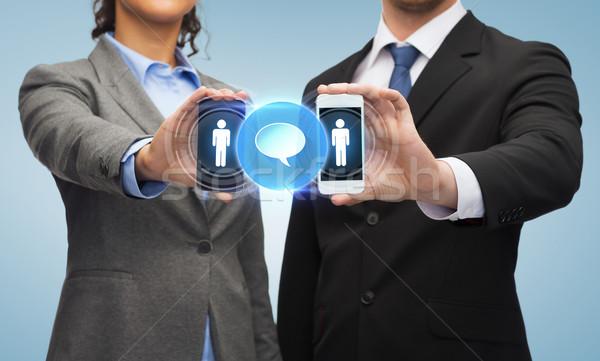 Biznesmen kobieta interesu działalności technologii społecznej Zdjęcia stock © dolgachov