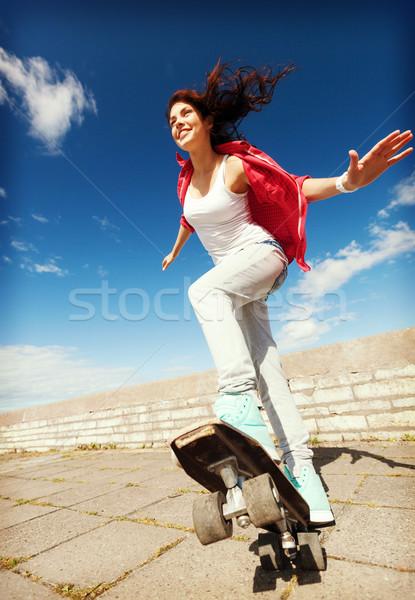 teenage girl skating outside Stock photo © dolgachov