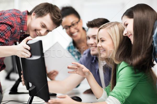 students looking at computer monitor at school Stock photo © dolgachov