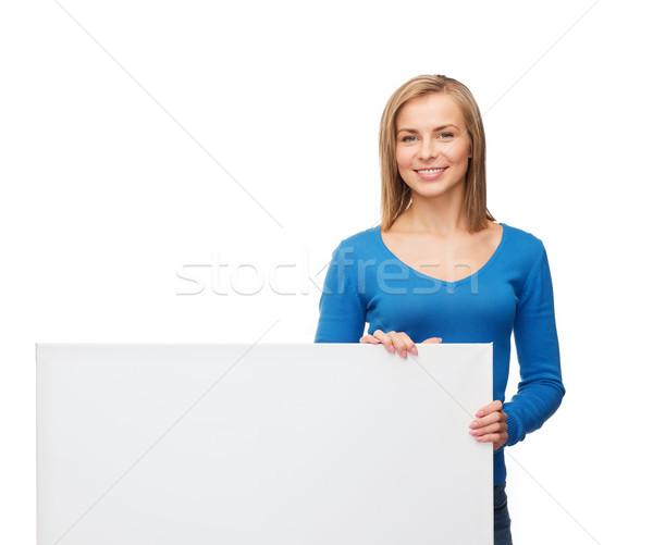 Mosolygó nő pulóver fehér tábla emberek hirdetés vásár Stock fotó © dolgachov