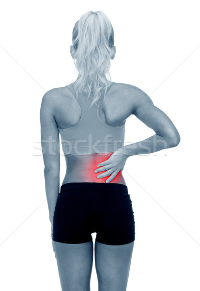 sporty woman touching her back Stock photo © dolgachov