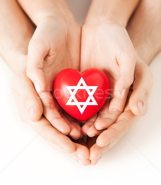 couple hands holding heart with star of david Stock photo © dolgachov