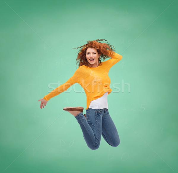 Souriant jeune femme sautant air bonheur liberté Photo stock © dolgachov