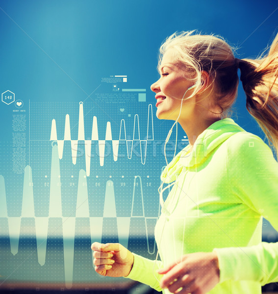 Stock photo: smiling woman doing running outdoors