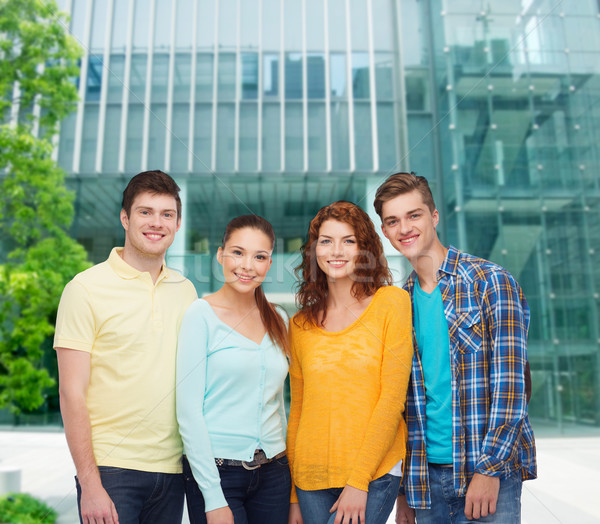 group of smiling teenagers over city background Stock photo © dolgachov