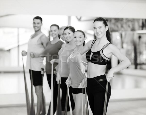 Persone gruppo gomma fitness sport formazione Foto d'archivio © dolgachov