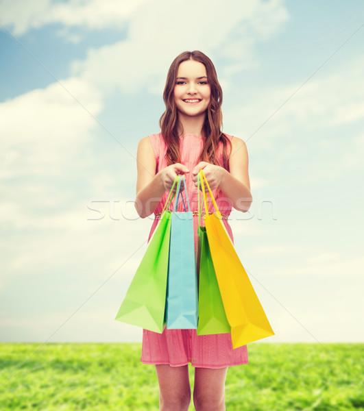 Gülümseyen kadın elbise çok perakende satış Stok fotoğraf © dolgachov