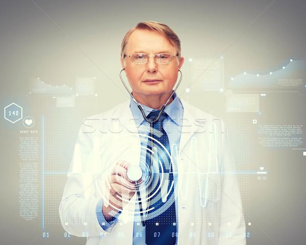 calm doctor or professor with stethoscope Stock photo © dolgachov
