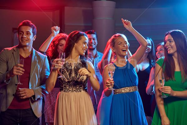 Boldog barátok szemüveg pezsgő klub buli Stock fotó © dolgachov