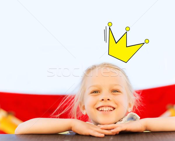happy little girl climbing on children playground Stock photo © dolgachov