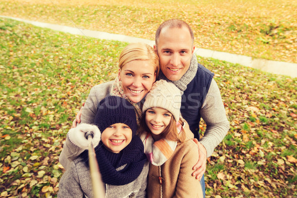 happy family with selfie stick in autumn park Stock photo © dolgachov