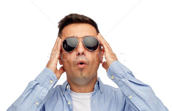 face of scared man in shirt and sunglasses Stock photo © dolgachov