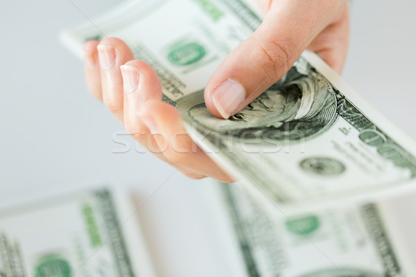 close up of woman hand counting us dollar money Stock photo © dolgachov