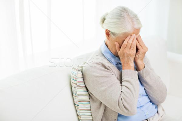 Starszy kobieta cierpienie głowy żal Zdjęcia stock © dolgachov