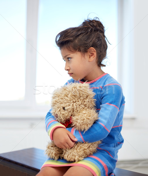 sad little girl with teddy bear toy at home Stock photo © dolgachov