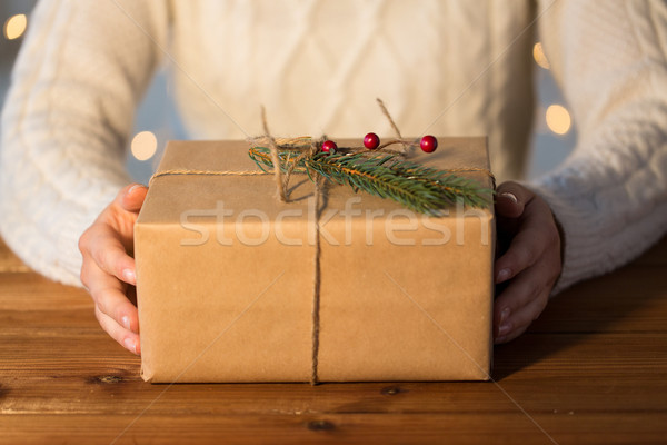 close up of woman with christmas gift or parcel Stock photo © dolgachov